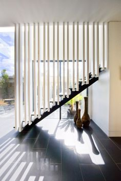 Steel support stringer | Painted Slat Balustrade | Slattery & Acquroff Stairs | stairking.com.au
