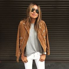 Jules Sarinara looked so chic in white jeans, a grey tee, and a camel suede moto jacket.