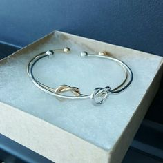 Best Friend Infinity Knot Bracelets One gold and one silver. Keep both or give one to a friend. Comes brand new in box. Minimalist Jewelry Co  Jewelry Bracelets