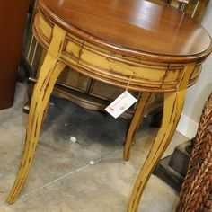Distressed painted yellow table