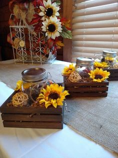 Wood box with mason jar and sunflower