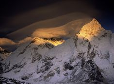 Ominous clouds hug the summit pyramid of Mount Everest in this photo. Sudden mountain storms have killed dozens of climbers over the years.