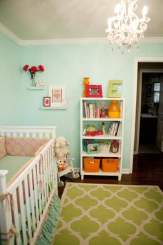 Love this paint color - Misty Teal by Benjamin Moore. Also, love the layered greens in this nursery!