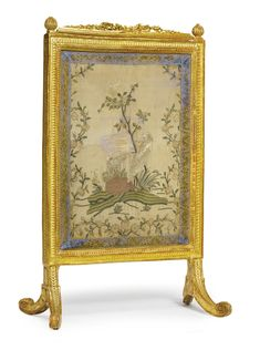 A LOUIS XVI CARVED GILTWOOD FIRE SCREEN circa 1780 upholstered à châssis with polychrome silk embroidered panel within gold galloon trim, European, late 18th century. height 41 1/2 in.; width 27 1/2 in