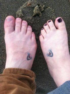 Shark tattoos on the beach