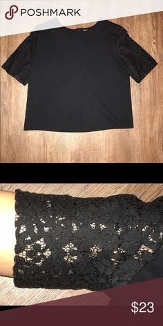 Ann Taylor LOFT Black Lace Sleeve Top Large Ann Taylor LOFT Black Lace Sleeve Tee // Size Large, Loose fit that is flattering and forgiving // Excellent Condition, only worn a few times // Perfect for work or play and will successfully pair with many pieces! LOFT Tops Blouses