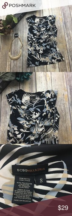 🎈 BCBGMAXAZRIA Sleeveless Floral Blouse Sleevless floral Blouse. Size small. In excellent condition.  Built in bra. 25 inches long. 15 inches arm pit to arm pit. BCBGMaxAzria Tops Blouses