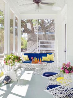 Eye-catching wicker furniture adds understated style to this airy porch. See the rest of this coastal cottage: http://www.bhg.com/decorating/decorating-style/cottage/a-colorful-coastal-cottage/?socsrc=bhgpin050713coastalcottageporch=2