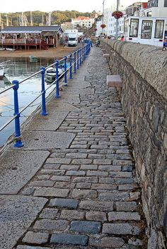 Guernsey~ St Peters Port, walkway along the water.