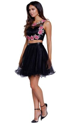 Look vibrant and youthful in this exquisite Nox Anabel 6228 ensemble. This short two-piece dress features an illusion sweetheart neckline with crop top styled with floral embroidery that splays to the back cut out. The dress has a zipper closure and is made of tulle fabric. The waist is cinched in a band and the multi-layered skirt finishes in a ruffled hemline. Celebrate their idyllic night in style while wearing this Nox Anabel ensemble.