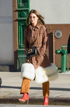 Keep warm in a fur trimmed Prada coat like Emily. Click 'Visit' to buy now. #DailyMail