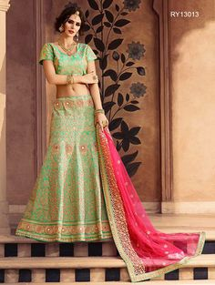 Buy Designer Bridal Lehengas, Wedding Lehengas Online : Super glam green raw silk unstitched lehenga choli featuring zari resham and mirror work. Paired with a matching dupatta. It can be customized upto size 42. *Call / Whatsapp / Viber : +91-9052526627 *Email : customercare@natashacouture.com *Worldwide Shipping | Free shipping in India | Cash on delivery *