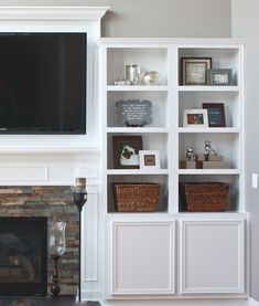 Perhaps we could do something like this to our fireplace. Add built-in bookcases to better use the empty walls.