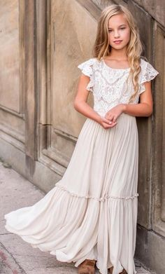 This gorgeous maxi dress is beautifully soft with a full, tiered skirt. The bodice is embellished with a beautiful lace overlay and fluttering lace sleeves. Center back invisible zipper. Self: Viscose, Lace; Preteen Fashion, Kids Fashion, Fashion Outfits, Fashion Clothes, Fashion Fashion, Baptism Dress, Tiered Skirts, Modest Dresses, Maxi Dresses