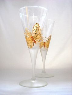 Champagne Wedding Glassware,Hand Painted Flutes Set of Two Golden Butterfly. $75.00, via Etsy.