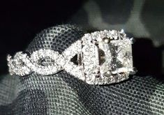 My engagement ring princess cut halo twisted band Neil Lane
