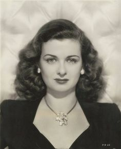 "1940s Spotlight *** # 41 - JOAN BENNETT (1910 ~ 1990) Joan Bennett (younger sister of actress Constance Bennett) worked steadily in films throughout the 1930s, but really hit her peak during the forties as a film noir femme fatale in Fritz Lang films - especially ""The Woman In The Window"" (1944) and ""Scarlet Street"" (45) both opposite Edward G. Robinson. During the 30s she was a blonde, but come the late 30s she changed her hair style and color to brunette (a la Hedy Lamarr). The change brou"