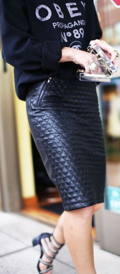 Graphic black sweatshirt and quilted patterned black leather pencil skirt. Conditional