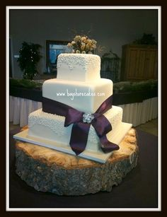 square cake with ribbon - don't really like those flowers, maybe some prettier flowers on each tier?