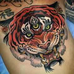 Neo traditional tiger chest piece by Sam Clark. neotraditional tiger chest SamClark