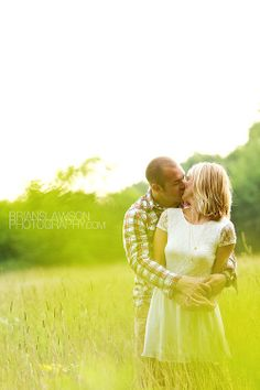 Photo by Brian Slawson Photography. Engagement shoot. #summer #field