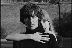 """George Harrison and Pattie Boyd, Esher, 1965. Taken by Henry Grossman. """"She put her arm around him, and the light was falling just perfectly for a portrait. I had to take it. And there it was. I've always loved the protective posture of Pattie's arm around George in those photos."""" - Henry Grossman"""