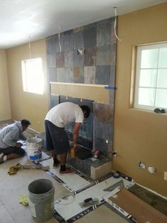 Tile crew doing what they do