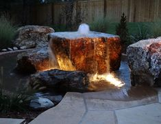 Mile High Landscaping used a cored two ton boulder to tie this water feature into the rest of the landscape. We used over 40 tons of accent boulders throughout the landscape to keep this project tied into its rustic feel. Space constraints didn't allow for a full size stream and pond, so we used just a small pond with cored boulder to allow for the movement and sound the client was looking for. Two boulders are placed at the edges of the pond so the clients can hang out on the edge or even…