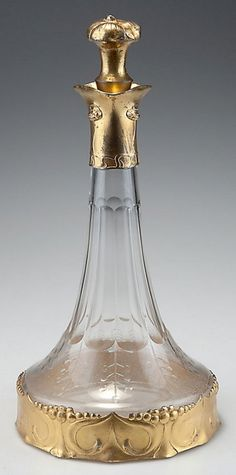 "Friedrich Adler (attributed). Carafe, c1902. H. 32.5 cm. Gilded pewter, cut glass. Marked: ""ISIS"", 710."