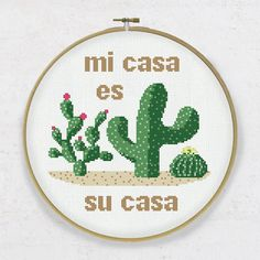 "The cross stitch pdf pattern ""Mi casa es su casa"" (My home is your home) is a sweet Mexican style welcome sign for your home. Three adorable cactuses with flowers will bring you joy stitching it and a cozy mood to your space."