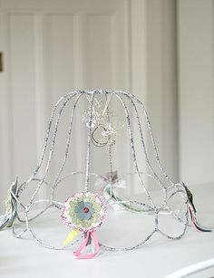 Crafts made with lampshade frames make your own ghost lampshade diyhomedecorating strip a dated lampshade down to bare bones and then greentooth Images