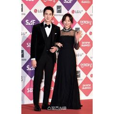 Seo Hyun Jin wearing a long lace dress with plumetis sleeves and embroidered collar rom the Blugirl Fall Winter 2016/17 Fashion Show Collection on the occasion of the SAF SBS Drama Awards.