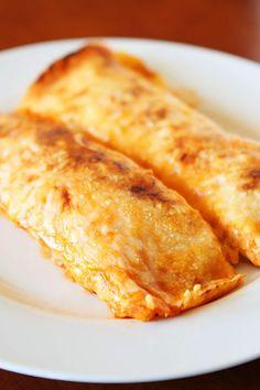 Cheesy Chicken Enchilada Style Burritos with cilantro-lime rice.