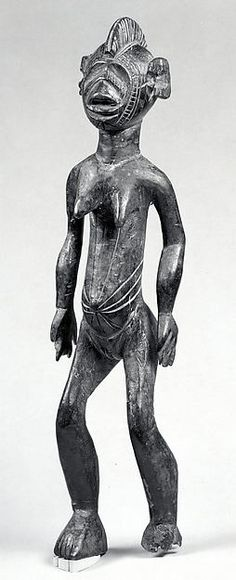 Figure: Female (Ninana)   19th–20th century Geography: Burkina Faso Culture: Mossi, Nakomse group Medium: Wood Dimensions: H.14 1/2 xW. 3 1/2 in. (36.8 x 8.9 cm)