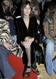 Front row fashion maven: Alexa Chung nailed a gothic glamour look on the front row for the Prada show at Milan Fashion Week on Thursday afternoon