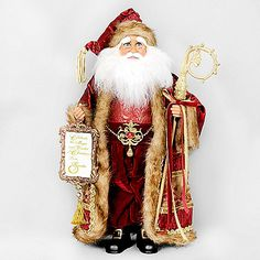 The Celebrate the Magic Santa from Karen Didion Originals brings the joy of Christmas into your home. The quality of this figurine is unmatched with its hand-painted face, glass inset eyes, real mohair beard, unique fabric, and detailed accessories.