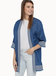 Exclusively from Twik - A boho-inspired piece accented by lovely embroidery and mini fringes at the ends - Organic cotton denim, to be eco-friendly and trendy - Open in front, perfect for layering The model is wearing size sml-med