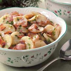 German Potato Salad-loved this and will make again with my modifications:  -1/2 c. sugar instead of 1 1/4c.  -try a malt vinegar next time or buy a higher quality cider vinegar?    this went great with our oktoberfest dinner of pork schnitzel and sauerkraut.