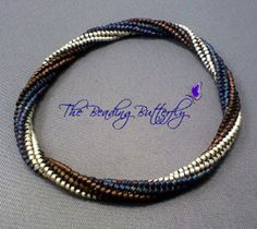 a free tutorial for making a spiral herringbone bangle with an invisible join. Click on the pic to go to the tutorial. If you don't want to make a bangle, instructions for adding a clasp are also included
