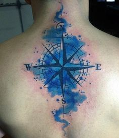Male With Blue Compass Watercolor Tattoo On Upperback