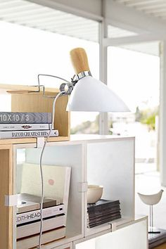 Good lighting in small spaces can add balance and brightness