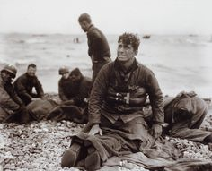 American soldiers on Omaha Beach recover the dead after D-Day 1944.