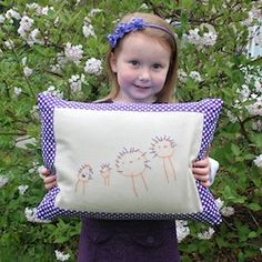 Embroider a family portrait drawn by your child and turn it into a pillow you can enjoy every day!