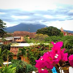 View from the roof deck of Hotel Spa Granada Pool, Granada, Nicaragua. Mombacho Volcano, thatched roofs, palm trees, photo from professionalsabbatical via Nicaragua Dispatch