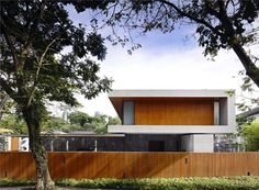 Contemporary tropical city house with teak cladding, lap pool, spiral stairs