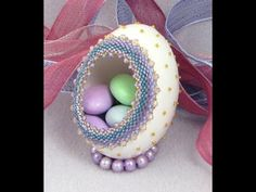 Learn how to decorate an egg with beads, how to cut it open without breaking, how to stitch decorations and glue them in place