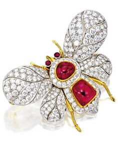 RUBY AND DIAMOND 'BEE' BROOCH Modelled as a bee, the thorax set with two cabochon rubies and ruby-set eyes together weighing approximately 6.50 carats, the wings set with brilliant-cut diamonds together weighing approximately 2.80 carats, mounted in 18 karat white and yellow gold.