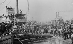 RESCUE: Photograph shows a boat with refugees at Vicksburg, Mississippi Mississippi River Flood of 1912.