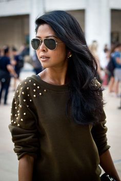 Studded sweater... She pulled it off