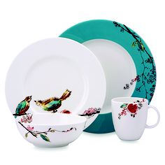 The Simply Fine Lenox® Chirp Dinerware serves as the canvas for an enchanting botanical scene.